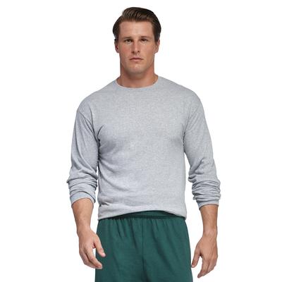 man facing front wearing a grey long sleeve shirt and green shorts