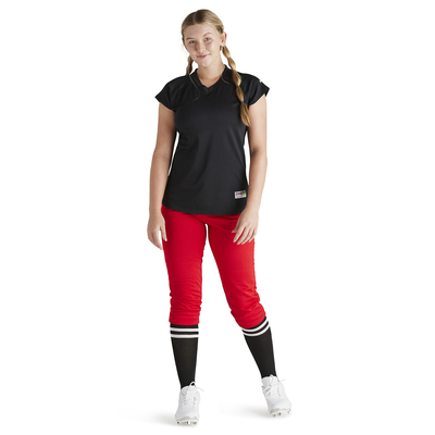 woman wearing red baseball pants and black vee neck baseball jersey