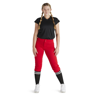 woman leaning on right leg wearing red baseball pants and black vee neck baseball jersey