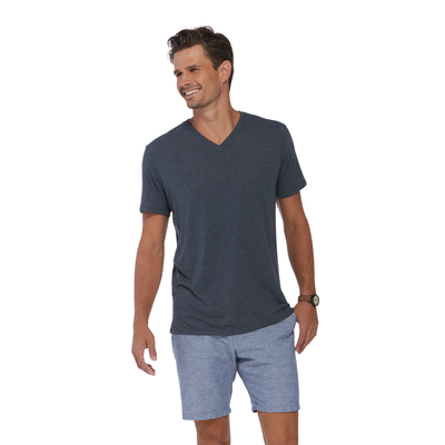man looking to the left wearing a grey v neck short sleeve platinum shirt
