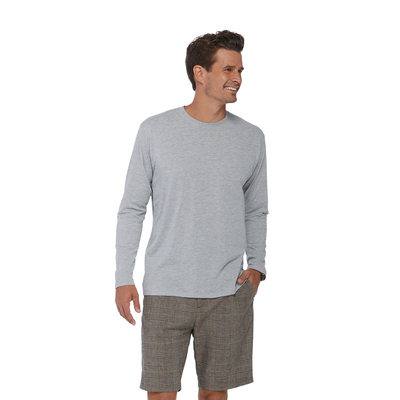 man looking to the right wearing a grey long sleeve crew neck platinum shirt