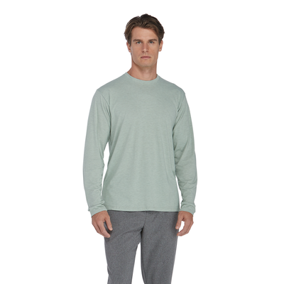 man facing front wearing a light green crew neck long sleeve platinum shirt