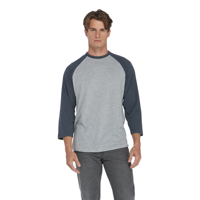 man facing front wearing a heather grey and navy raglan sleeve platinum tee