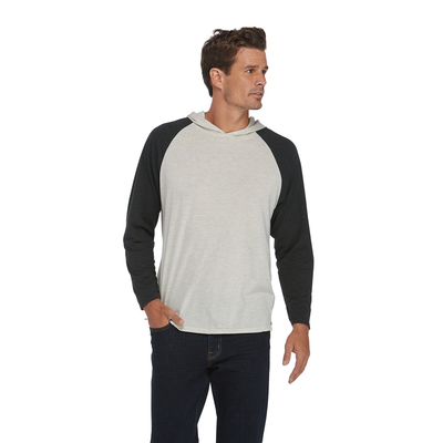 man looking to the right wearing an oatmeal and black raglan sleeve hoodie platinum shirt