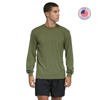 man looking to the left wearing a green long sleeve shirt and black running shorts