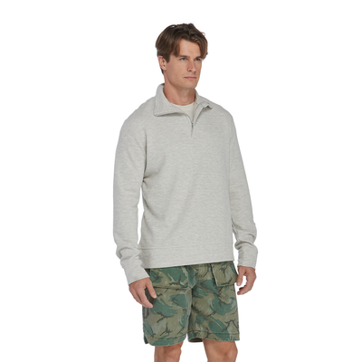 man angled to the right wearing an oatmeal quarter zip platinum pullover